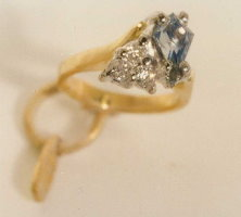 18ct Yellow and White Gold charm set with a kite Sapphire and three 1 point Diamonds.